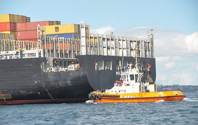 Tugs at Port Louis, appearing in Africa PORTS & SHIPS