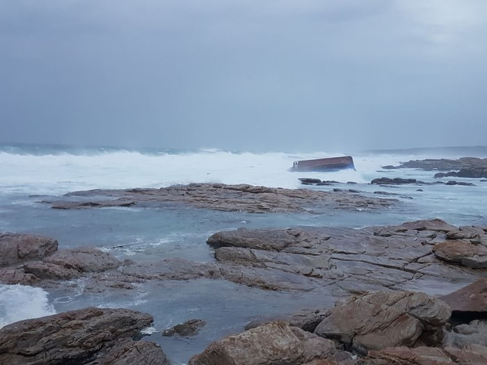 The Chokka fishing boat Maredon capsized at Sunset Rocks, Cape St Francis. Picture: NSRI St Francis Bay, appearing in Africa PORTS & SHIPS maritime news