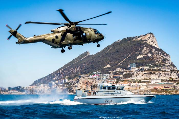 Global Operations Award 2017, Highly Commended. Awarded to the best single image that is judged to create the most impact portraying the Royal Navy's global maritime responsibilities. Pictured is a Commando Helicopter Force Merlin Mk3 helicopter and HMS Scimitar, a Scimitar Class Fast Patrol Boat, conducting reassurance and demonstration of UK sovereignty in British Gibraltar Territorial Waters. Working from RAF Gibraltar, two Merlin Mk3 helicopters from 846 Naval Air Squadron based at Royal Naval Air Station Yeovilton, Somerset were consolidating their contingency deployment capability during Exercise Barbary Commando 16 of August 2016. Photo: MoD Crown Copyright 2017 ©. Appearing in Africa PORTS & SHIPS maritime news