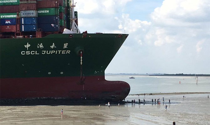 CSCL Jupiter aground. Picture by Fleetmn, appearing in Africa PORTS & SHIPS maritime news