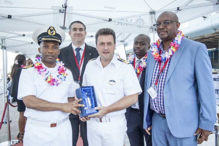 Port of Durban Harbour Master Captain Alex Miya receives a gift from Captain Lauro Maresca of MSC Cruises, flanked by Durban Port Manager Moshe Motlohi and (back left to right) Ross Volk, MD of MSC Cruises South Africa and Councillor Sqiniseko Shezi, appearing in Africa PORTS & SHIPS maritime news