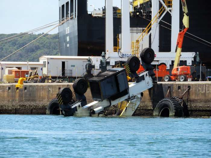 Storm damage - straddle carrier over the side at Pier 1. Picture: Ken Malcolm, appearing in Africa PORTS & SHIPS maritime news