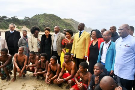 Transport Minister Mr Joe Maswanganyi and his deputy, Ms Sindisiwe Chikunga (in floral dress) posing for a photograph with State officials and youths recently trained as lifeguards through a SAMSA driven marine skills development programme for the youth of Port St Johns and the OR Tambo District Municipality. The youth were awarded their certificates during the celebration of World Maritime Day 2017 held in the town last Thursday. Appearing in Africa PORTS & SHIPS maritime news