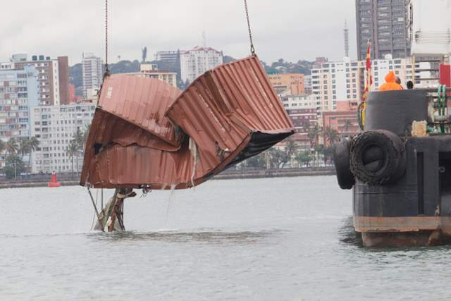 TNPA's floating crane INDLOVU (elephant) and divers recover one of several missing containers, overboard during the big storm of 10 October 2016. Picture: SAMSA, appearing in Africa PORTS & SHIPS maritime news