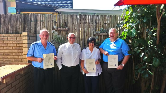 (left to rght) Revd Paul Richardson, Revd Boet van Schalkwyk, Missionary Jessie John, Chaplain Steve van Schalkwyk with their certificates, appearing in Africaq PORTS & SHIPS maritime news