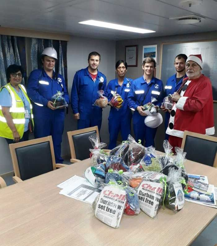Santa and a chaplain with some of the crew of MSC Earth, featuring in Africa PORTS & SHIPS maritime news