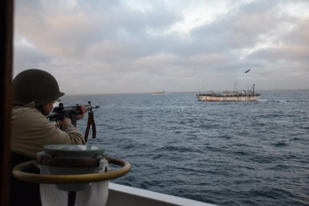 Warning fire across bows of fishing vessel, appearing in Africa PORTS & SHIPS maritime news