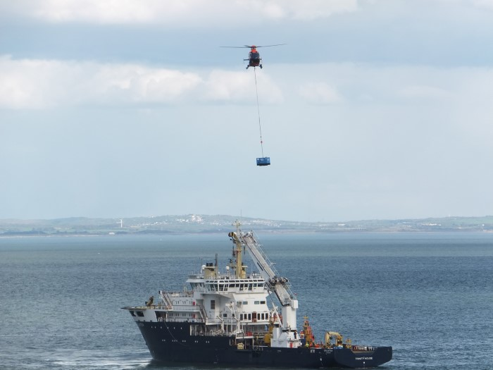 A generator being winched from the Trinity House vessel Galatea, featuring in Africa PORTS & SHIPS maritime news