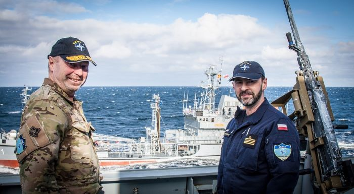 The Commander of Standing NATO Maritime Group One (SNMG1) with his Polish Navy Staff Communications Officer on HDMS Niels Juel during a Replenishment At Sea (RAS) approach with the ORP Bałtyk (in the background). Featured in Africa PORTS & SHIPS maritime news