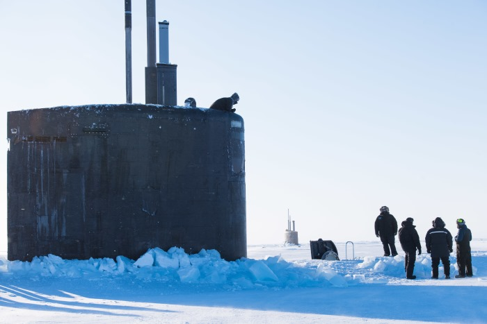 The Seawolf-class fast-attack submarine USS Connecticut (SSN 22) and the Los Angeles-class fast-attack submarine USS Hartford (SSN 768) break through the ice 10 March, 2018 in support of Ice Exercise (ICEX) 2018. ICEX 2018 is a five-week exercise that allows the US Navy to assess its operational readiness in the Arctic, increase experience in the region, advance understanding of the Arctic environment, and continue to develop relationships with other services, allies and partner organizations. US Navy photo by Mass Communication 2nd Class Micheal H. Lee/Released ©, featuring in Africa PORTS & SHIPS maritime news