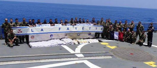 Some of the crew of FS La Fayette with the drug haul from the stateless dhow, from a story appearing in Africa PORTS & SHIPS maritime news