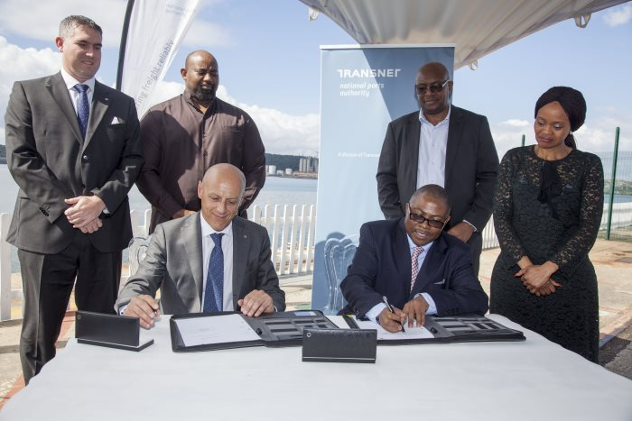 From left to right standing – Ross Volk (KCT), Moshe Motlohi (Acting COO of TNPA), Nkululeko Mchunu (KCT),Shulami Qalinge (Chief Executive of TNPA). Seated are Gianluca Suprani (KCT) and Siyabonga Gama (Transnet Group Chief Executive) at signing of agreement to build new cruise terminal at the port of Durban.  Story appearing in Africa PORTS & SHIPS maritime news
