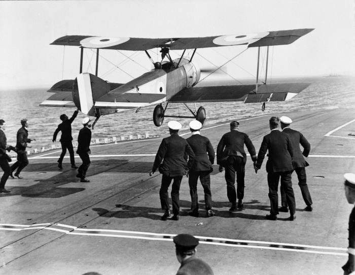 RAF 100 B Image: DDC-45163717 Pictured is Squadron Commander EH Dunning attempting to land his Sopwith Pup (N6453) on the flight deck of HMS Furious for the second time on 7 August 1917, five days after his first success. Photo: MOD Crown Copyright 2018 © from a stori in Africa PORTS & SHIPS maritime news