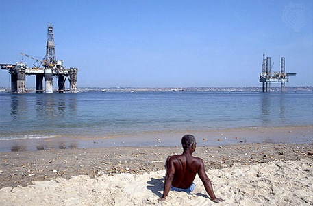 Oil rigs off the beach in Angola, from a story in Africa PORTS & SHIPS maritime news