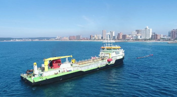 TNPA's Ilembe dredger out at sea connected to a floating pipeline that has been pumping sand directly from the dredger onto Durban's beaches, as reported in Africa PORTS & SHIPS maritime news