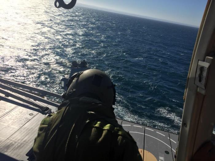 Rendezvous between SA Air Force helicopter from 15 Squadron, Charlie Flight, and bulker KS Flora off the coast of East London.  Picture courtesy:  NSRI.  This appeared in Africa PORTS & SHIPS maritime News