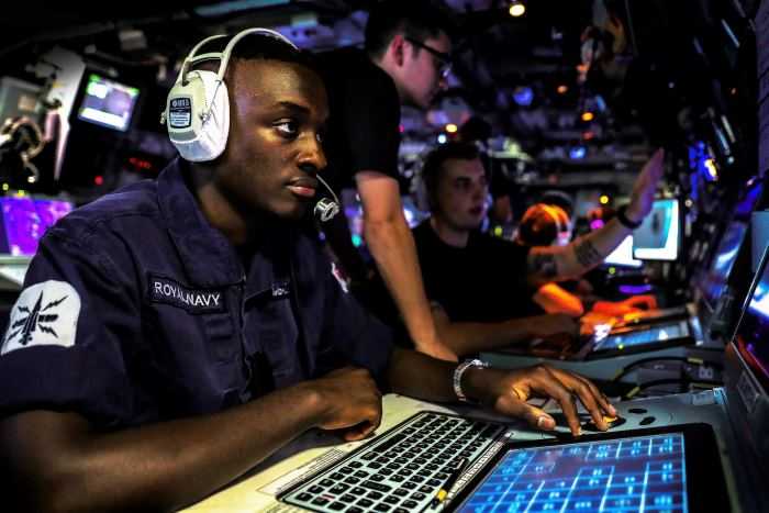 Part of the winning portfolio in the Canon Royal Navy Photographer of the year award. AB(WS)* Aspen Mbabazi takes part in an air defence exercise where personnel were closed up on the Bridge and in the Operations Room. On 20 October 2017, HMS Monmouth took part in Exercise Intrepid Sentinel. The exercise which comprised of HMS Monmouth, USS Shoup and French warship Jean Bart saw various evolutions take place, including boarding exercises, Air Defence Exercises, Officer of the Watch manoeuvres, helicopter cross deck landings, and finalised with all three Units taking part in a PHOTEX (Photographic Exercise). *Able Seaman Warfare Specialist. Photo: LPhot Dan Rosenbaum HMS Monmouth. MoD Crown Copyright 2018 ©, featured in Africa PORTS & SHIPS maritime news