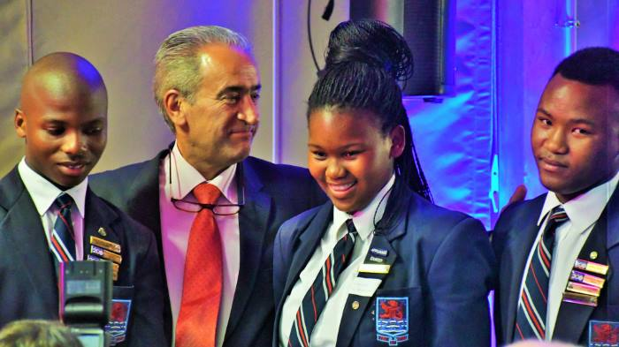 Dr Iraj Abedian, of South Africa's top economists who is CEO of Pan-African Capital Holdings as well as Chairman of Amsol board of directors, flanked by three of about a dozen Simon's Town School Lawhill Maritime Centre matric pupils who received awards in recognition of their academic performance at the school on Thursday, featuring in Africa PORTS & SHIPS maritime news