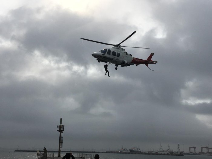 Under the stormy clouds of Cape Town the TNPA port helicopter tests the feasibility of augmenting the marine pilot transfer service, featured in Africa PORTS & SHIPS maritime news