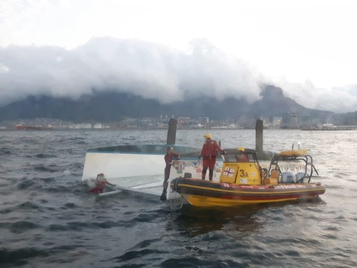 Capsized catamaran Escape Catin Table Bay, picture NSRI, featured in Africa PORTS & SHIPS maritime news