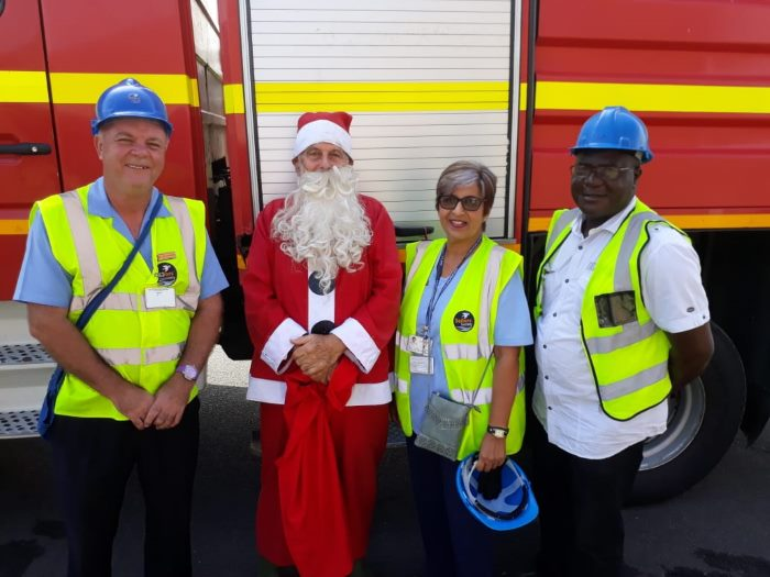 Santa's helpers. Chaplain Richardson (left) and ship visitor Jessie Paul (second from right), chalking up the steps,featured in Africa PORTS & SHIPS maritime news