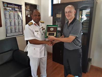Commander Okafor of the Nigerian Navy Hydrographic Office with John Smart, Senior Geomatics Analyst-Teledyne CARIS, Picture: Teledyne CARIS, featured in Africa PORTS & SHIPS