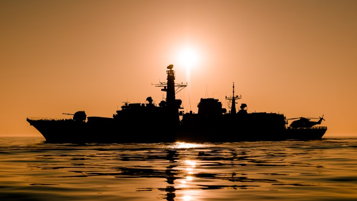 Image of HMS St Albans silhouetted at sunset. Featured in Africa PORTS & SHIPS