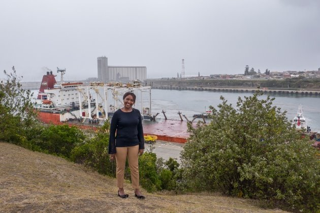 Sharon Sijako TNPA Port Manager for the Port of East London, with port and Zhen Hua 20 in background, featured in Africa PORTS & SHIPS