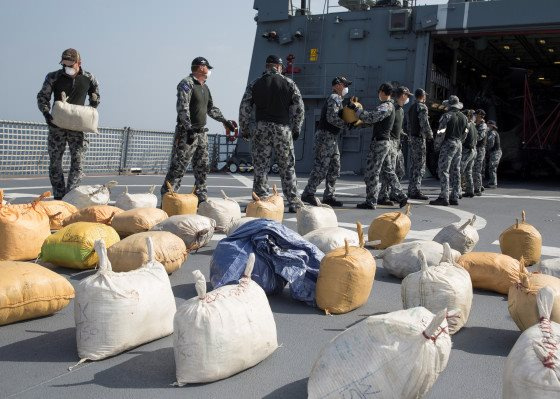 HMAS Ballarat's boarding party lays out the seized hashish on the ship's flight deck, featured in Africa PORTS & SHIPS