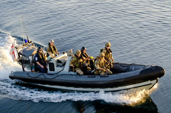 Royal Navy and Royal Marines boarding party on RIB from HMS Dragon, featured in Africa PORTS & SHIPS