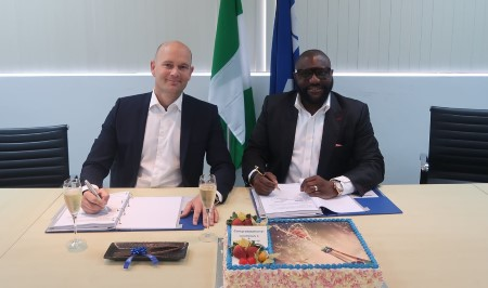 Mark Gaetje (Sales Manager, Damen Shipyards Group) and Dr Louis Ekere (Managing director, Homeland Integrated Offshore Services Ltd) during the signing ceremony for two additional Damen 3307 patrol vessels, featured in Africa PORTS & SHIPS