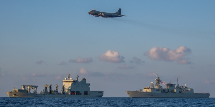 A Royal Canadian Air Force CP-140 Aurora conducts a fly past over HMCS REGINA, and NRU ASTERIX in the Seychelles on 31 March 2019, which featured in Africa PORTS & SHIPS maritime news