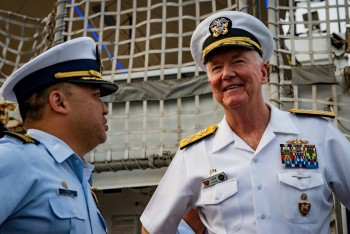 Adm. James G. Foggo III, right, commander of U.S. Naval Forces Europe-Africa and Allied Joint Force Command Naples, Italy, speaks with Coast Guard Cmdr. Randall Chong, commanding officer of USCGC Thetis (WMEC-910), aboard the ship during Exercise Obangame Express 2019 in Lagos, Nigeria on March 21, 2019. US Navy picture, featured in Africa PORTS & SHIPS maritime news online