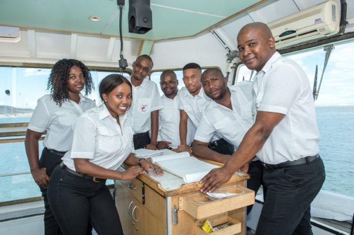Trainee Tug Masters at Port of Ngqura (left to right) Ntombizonke Khayisa, Olwethu Mzimeli, Makabongwe Sibandile, Anda Mzinyathi, Lulamile Mnyila, Bongi Nomqhuphu and Awonke Notshulwana, featured in Africa PORTS & SHIPS maritime news