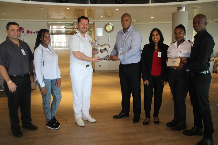 Left to right: Adrian Lee and Thembelihle Gqwaru of vessel agent Rennies Ships Agency; Captain Iulian Albici, Staff Captain of MS Silver Whisper accepting a commemorative plaque from Richards Bay Port Manager, Thami Sithole; Senior Operations Manager Christina Reddy; Deputy Harbour Master Captain Nompumelelo Mkhize and Maxwell Dzanibe of Rennies Ships Agency, featured in Africa PORTS & SHIPS maritime news online