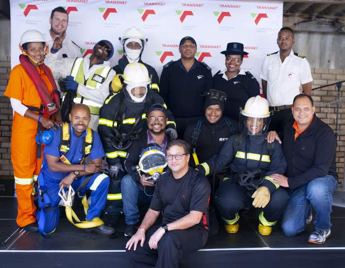Port Elizabeth Port Manager, Rajesh Dana (front)and Harbour Master, Captain Brynn Adamson (front row, far right) with employees showcasing their Personal Protective Equipment (PPE) from marine services, the harbour master's department, the civil depot, diving, garden services, fire and emergency services as well as port security, featured in Africa PORTS & SHIPS maritime news online