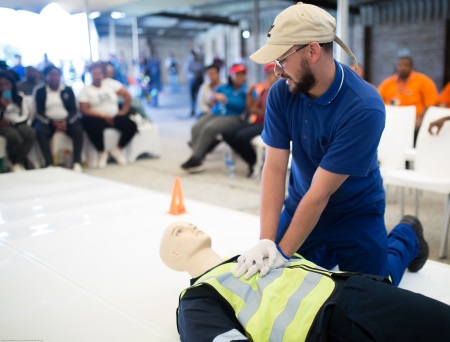 Jefferson Isaacs from the port's diving section performs a cardiopulmonary resuscitation (CPR) demonstration in the port of Port Elizabeth, featured in Africa PORTS & SHIPS maritime news online