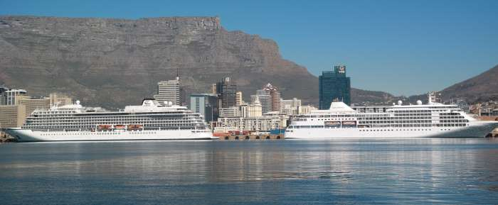 Viking Sun, calling at South African ports for the first time this week, pictured in the Port of Cape Town on 18 April, with Table Mountain in the background. Next to her is the Silverseas ship Silver Whisper. Pictures: TNPA, featured in Africa PORTS & SHIPS maritime news online