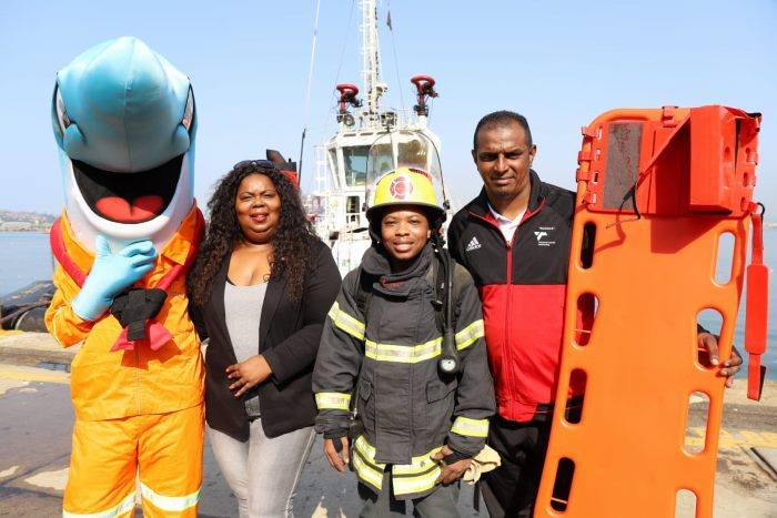 Port mascot iSenzo and port manager Nokuzola Nkowane and staff taking part in the World Day for Safety & Health at Work at the Port of Durban, featured in Africa PORTS & SHIPS maritime news online