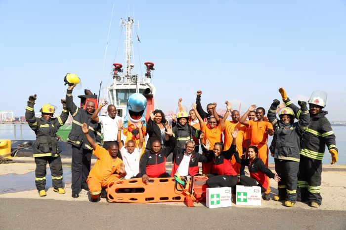 The port's safety mascot iSenzo was part of last Friday's commemoration at Durban Harbour, where Acting Port Manager Nokuzola Nkowane addressed port employees on the day. iSenzo is the funny looking guy left of centre in the back row. You'll notice him again in the picture lower down, standing next to the acting port manager, Nokuzola Nkowane. Featured in Africa PORTS & SHIPS maritime news online