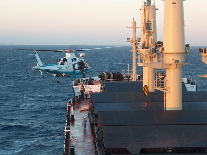 Action shot of the Richards Bay helicopter lowering a marine pilot onto a bulker outside port. Picture: Terry Hutson, featured in Africa PORTS & SHIPS maritime news online