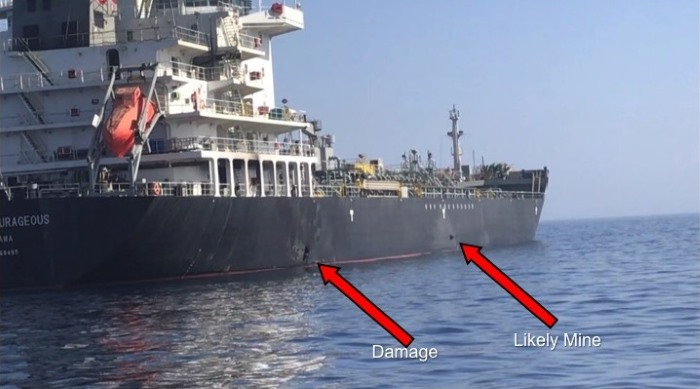 In this Powerpoint slide provided by U.S. Central Command damage from an explosion, left, and a likely limpet mine can be seen on the hull of the civilian vessel M/V Kokuka Courageous in the Gulf of Oman, 13 June 2019, as the guided-missile destroyer USS Bainbridge (DDG 96), not pictured, approaches the damaged ship. Sailors aboard Bainbridge aided the crew of Kokuka Courageous. Bainbridge is deployed to the U.S. 5th Fleet areas of operations in support of naval operations to ensure maritime stability and security in the Central Region, connecting the Mediterranean and Pacific through the western Indian Ocean and three strategic choke points. U.S. Navy photo ©/Released, appearing in Africa PORTS & SHIPS maritime news
