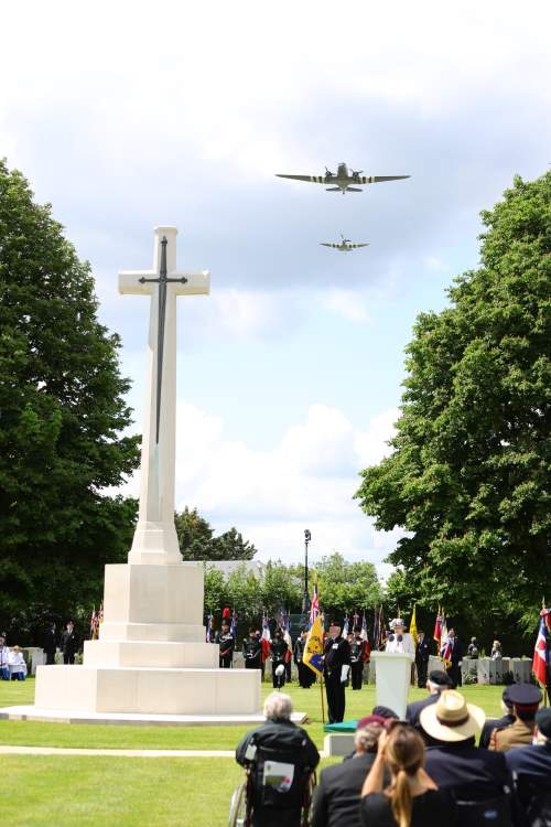 Normandy, Thursday: During the Royal British Legion's Service of Remembrance at the Commonwealth War Graves Commission Cemetery at Bayeux, there was a flypast of a Dakota and a Spitfire bearing the Overlord stripes worn by all Allied aircraft during the invasion. Picture: MoD Crown Copright 2019 ©, featured in Africa PORTS & SHIPS maritime news online