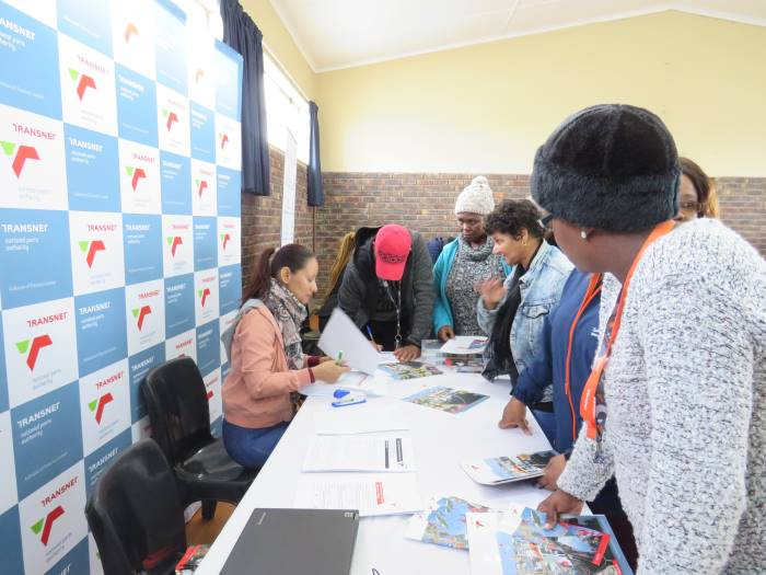 Lynne-Ann Prins of the TNPA Mossel Bay Procurement department engaging with representatives of local SMMEs at the Mossel Bay Municipality SMME Expo, featured in Africa PORTS & SHIPS maritime news online