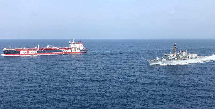 HMS Montrose escorting SDtena Important and Sea Ploeg through the Strait of Hormuz. Picture MOD.