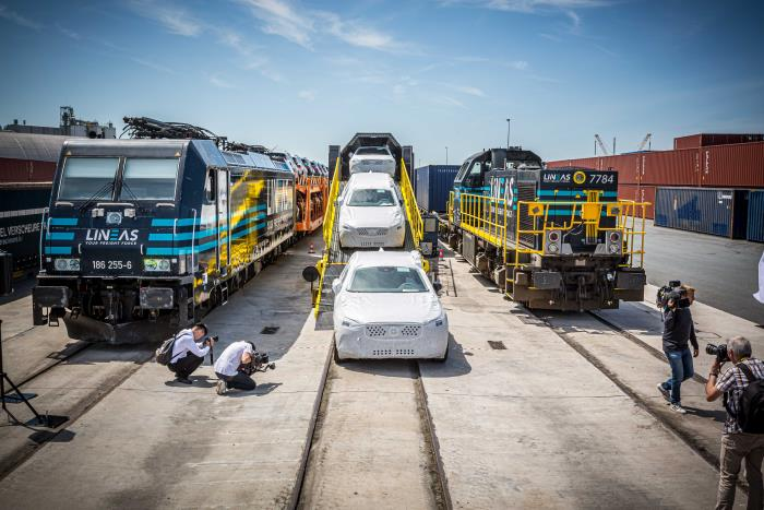 Loading into covered wagons as part of the service to Poland. Photo: Volvo Car Gent ©, featured in Africa PORTS & SHIPS maritime news