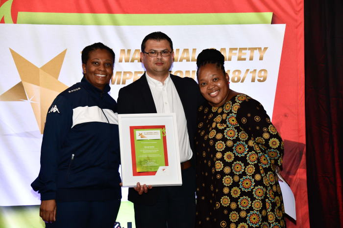 Saldanha Port Manager Vernal Jones accepts his Best Port Manager Health and Safety Award from TNPA Acting Chief Executive Nozipho Mdawe (left) and Transnet SOC Ltd TIMS Director and GM CCRO Office Mirriam Tenyane (right). The Port of Saldanha was also recognised for achieving OHSAS 18001 and ISO 14001 certification and was one of three ports to scoop the Silver Membership Award for achieving a disabling injury frequency rate (DIFR) of zero for one year. The port's lobster mascot, Rooy, also won the Best Safety Mascot award, featured in Africa PORTS & SHIPS maritime news