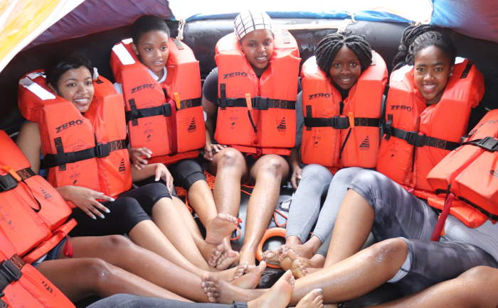 Students, from left, Erenique Solomon, Masibulele Rixana, Izandry Mabotja, Siyamthanda Faliso and Mihlali Mfana, practice the correct position for sitting in a life raft. They were part of a group of female high school learners and university students who got a practical taste of the maritime working world and gained vital sea safety skills in a short course sponsored by Siyaloba Training Academy and the South African International Maritime Institute (SAIMI). Picture: Sinomtha Gede, featured in Africa PORTS & SHIPS maritime news