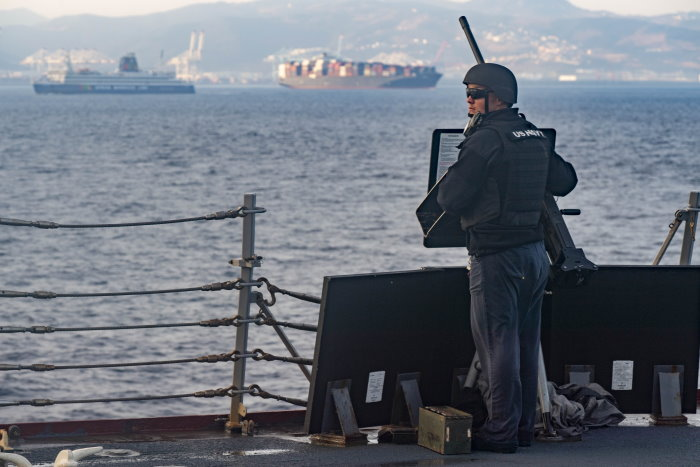 190927-N-RJ834-0063 STRAIT OF GIBRALTAR (Sept. 27, 2019) Gunner's Mate 2nd Class Tyler Shiplet mans a .50-caliber machine gun as the Arleigh Burke-class guided-missile destroyer USS Lassen (DDG 82) transits the Strait of Gibraltar. Lassen is operating in support of naval operations to maintain maritime stability and security in order to ensure access, deter aggression and defend U.S., allied and partner interest. (U.S. Navy Photo by Mass Communication Specialist 2nd Class Tamara Vaughn/Released), Featured in Africa PORTS & SHIPS maritime news
