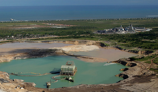 Aerial view of the Moma Titanium Minerals Mine, with the jetty used to transship the mineral to bulk carriers at anchor offshore to be seen on the shoreline, featured in Africa PORTS & SHIPS maritime news